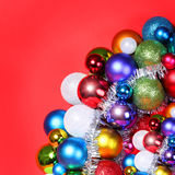 Christmas Balls. Colorful Christmas Decorations over red Stock Image