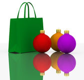 Christmas Balls and Colors shopping bags. On white Stock Photo