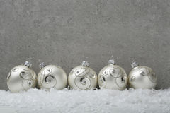 Christmas balls on concrete background Royalty Free Stock Photography