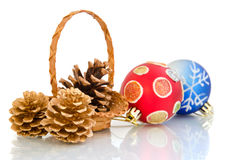 Christmas balls and cones in a basket Stock Images
