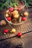 Christmas balls, cones and walnuts Stock Photos