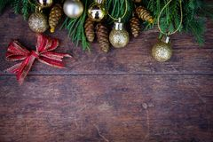 Christmas balls decor on old wood background.  stock photography