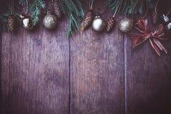 Christmas balls decor on old wood background.  royalty free stock image