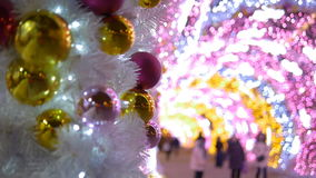 Christmas balls decorate the city. The tunnel of glowing lights. stock video footage