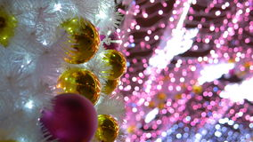 Christmas balls decorate the city. The tunnel of glowing lights. Christmas balls decorate the city. Close-up 4K stock video footage