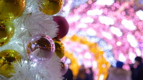 Christmas balls decorate the city. The tunnel of glowing lights. Christmas balls decorate the city. Close-up 4K stock footage