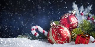 Christmas balls and decoration on snow. New Year`s card royalty free stock photo