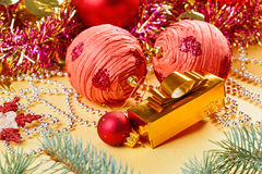 Christmas balls and decorations on golden Stock Photography