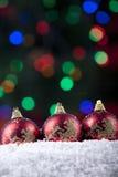 Christmas balls with defocused christmas lights Royalty Free Stock Image