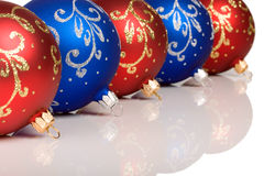 Christmas balls on diagonal. Red and blue christmas balls on diagonal on white background Stock Photography