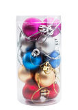 Christmas balls of different colors in transparent plastic box i Stock Images