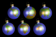 Christmas balls with earth. Isolated on black Royalty Free Stock Photos