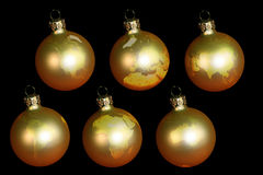 Christmas balls with earth. Isolated on black Royalty Free Stock Photo