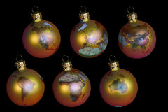 Christmas balls with earth. Isolated on black royalty free stock image