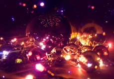 Christmas balls and electric garland. Stock Photography