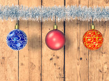 Christmas balls and festoon. Christmas decorations on wooden background, empty space at bottom for custom text or image (3d render Stock Photo