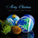 Christmas balls and fir on black background Royalty Free Stock Image