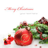 Christmas balls and fir branches with decorations Stock Image
