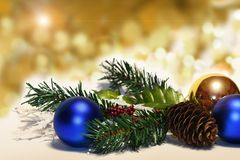 Christmas balls and fir branches with decorations on abstract background, blurred, sparking, glowing. stock images