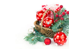 Christmas balls and fir branches with decorations isolated over Stock Image