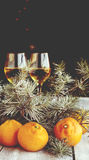 Christmas balls with fir branches and glasses of champagne Royalty Free Stock Images