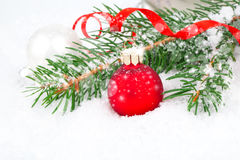 Christmas balls and fir branches on a snow Stock Photography