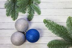 Christmas balls and fir branches on wooden background, happy new year, top view stock photos