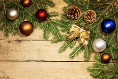Christmas balls and fir cones and branches Stock Image