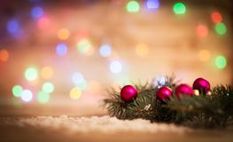 Christmas balls and fir-tree branches on wooden background. Royalty Free Stock Photography