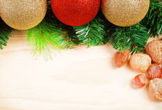Christmas balls with fir-tree branches on wooden Royalty Free Stock Image