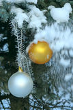 Christmas balls on a fir-tree in snow Royalty Free Stock Photos