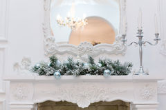 Christmas balls on the fireplace. Blue Christmas balls on the fireplace in the interior Royalty Free Stock Photos