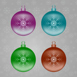Christmas balls. Four Christmas tree ball with snowflakes on the winter background Royalty Free Stock Photography