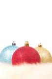 Christmas balls on fur Stock Image