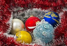 Christmas balls with garland Royalty Free Stock Images