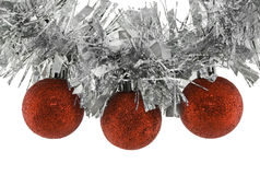 Christmas balls on garland. Three red Christmas balls attached on a garland Royalty Free Stock Photography