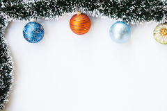 Christmas balls and garland frame Stock Photos