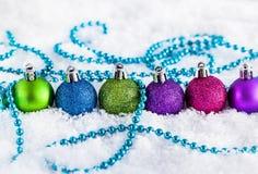 Christmas balls and garland Stock Photos