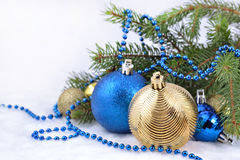 Christmas balls and garland on a spruce branch Stock Photo