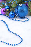 Christmas balls and garland on a spruce branch Royalty Free Stock Photography