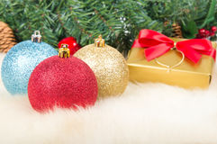 Christmas balls and gift Stock Images