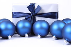 Christmas balls and a gift background Stock Images