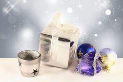 Christmas balls, a gift box and a candlestick Stock Images