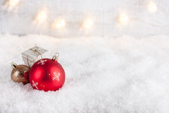 Christmas balls and gift box on snow Royalty Free Stock Photography