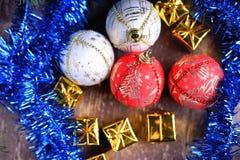 Christmas balls, gift boxes and blue garland Royalty Free Stock Photo
