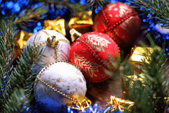 Christmas balls, gift boxes and fir tree branch Royalty Free Stock Photography