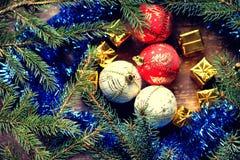 Christmas balls, gift boxes and fir tree branch Stock Photos
