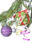 Christmas balls, gift and decoration on fir tree Stock Photography