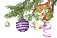 Christmas balls, gift and decoration on fir tree Royalty Free Stock Photos