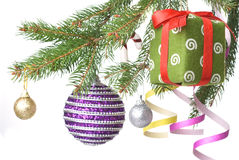 Christmas balls, gift and decoration on fir tree Royalty Free Stock Images